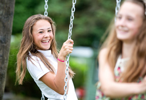 girls on swings at fell end