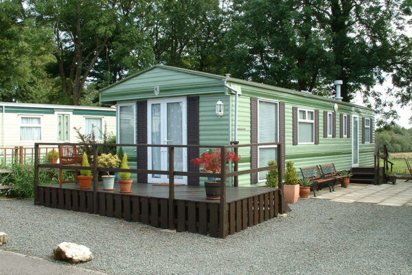 static caravan for sale with decking at hall more, silverdale and arnside