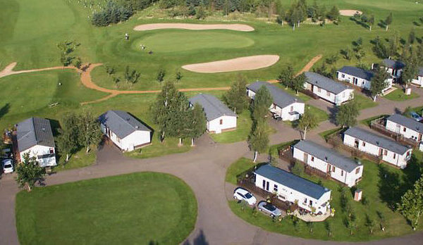 Row of Holiday Lodges overlooking Golf Course