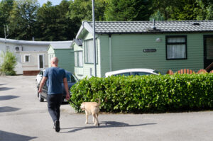 Man walking dog at Fell End