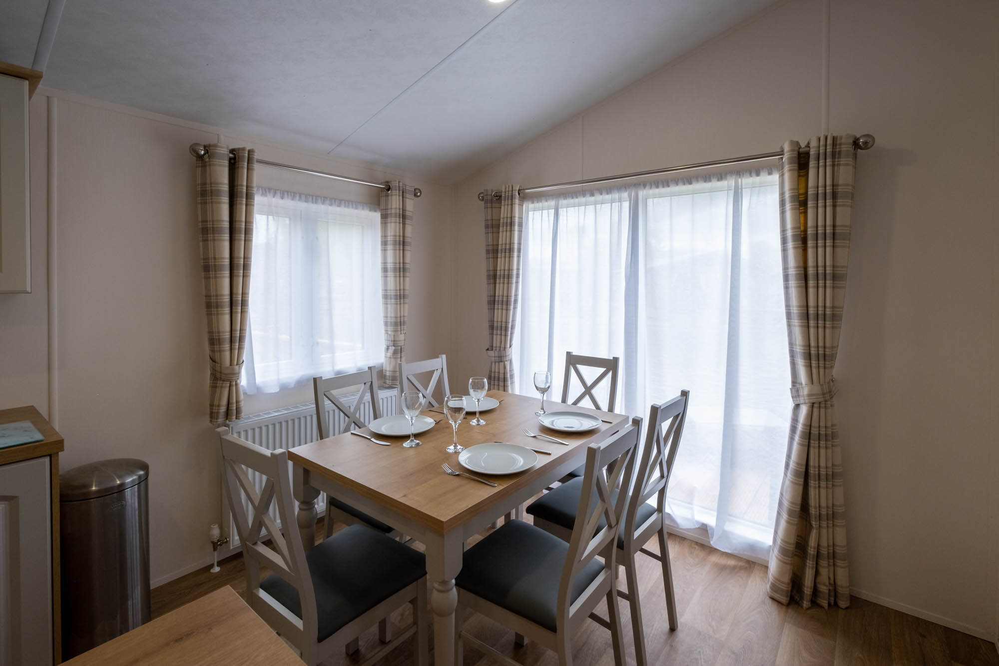 Dining Room with Checked Curtains